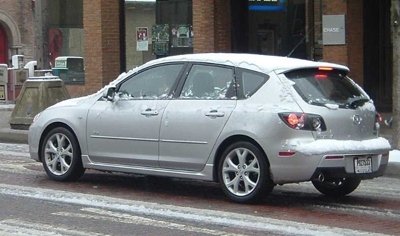 Gray-Mazda-3-covered-in-snow